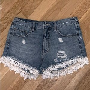 Free People denim shorts with white lace trim